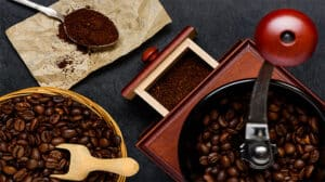 Coffee Grinder and Roasted Brown Beans with ground